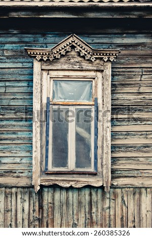 Old wooden window. Russian traditional style toned photograph - stock photo