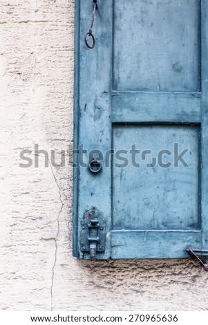 Old wooden window shutter details - stock photo