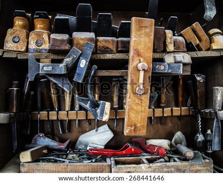 Old woodworker tools, shelf, carpenter - stock photo