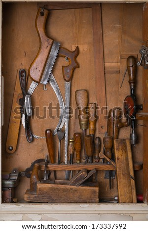 Old woodworking tools in carpentry shelf. - stock photo