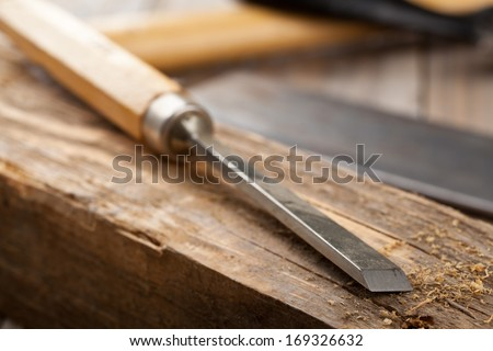 Old woodworking tools on workbench in craftsman's shop - stock photo