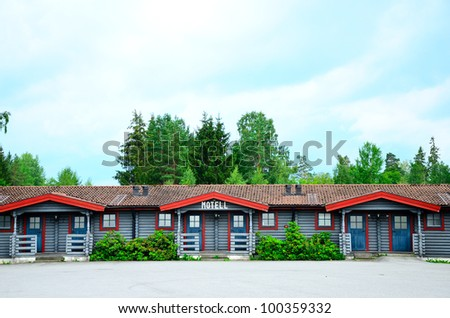 Old woody motel close to highway in Sweden. - stock photo
