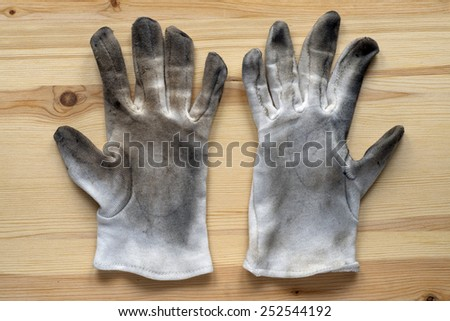 old work gloves and brush - stock photo