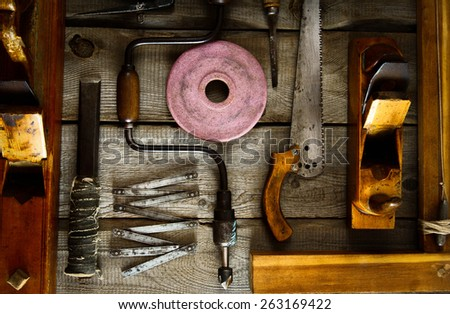Old working tools. Various tools on a wooden background. - stock photo