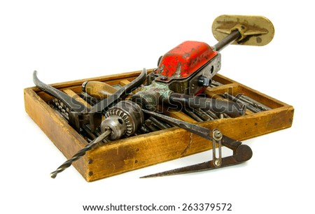 Old working tools. Vintage working tools ( drill, old box and others) on white background. - stock photo