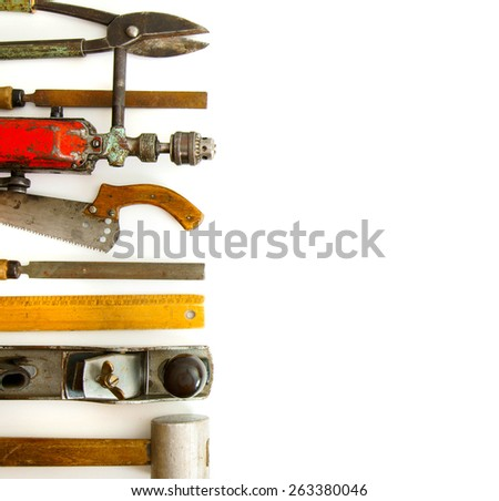 Old working tools. Vintage working tools (drill, ruler and others) on white background. - stock photo