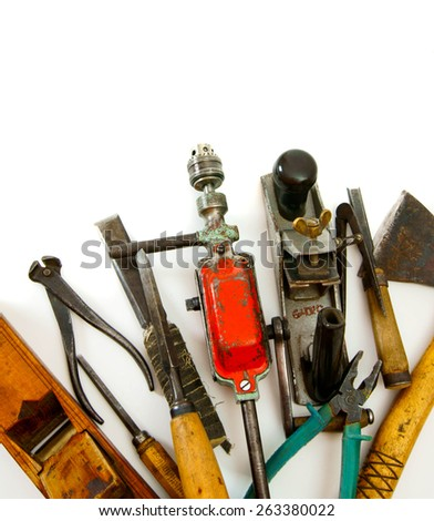 Old working tools. Vintage working tools ( drill, saw and others) on white background. - stock photo