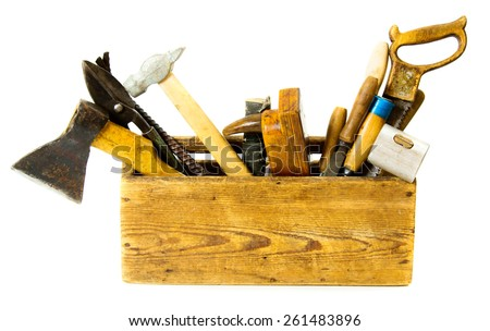 Old working tools. Working tools (saw, axe, chisel and others) in an old box on white background. - stock photo