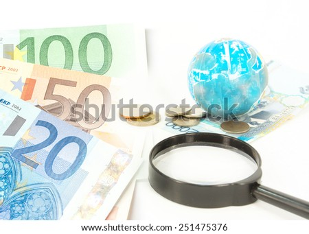 old world globe ,money and a magnifying glass, on white background. abstract background to solution of import,export,and on line international commercial. - stock photo