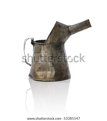 Old worn and dirty metallic oil can - stock photo