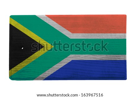 Old worn and scratched wooden cutting board with the South African flag on it