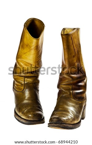 Old worn cowboy style boots from the seventies of the twentieth century - isolated - stock photo