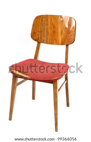 Old worn-out wooden chair isolated on white.