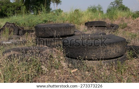 Old worn tires for recycling - stock photo