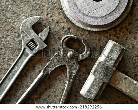 Old wrenches on a wooden background - stock photo