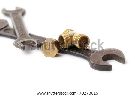 old wrenches to repair on a white background