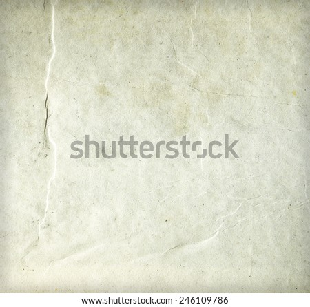 Old wrinkled dirty beige paper sheet texture for background with copyspace for text.. Closeup - stock photo