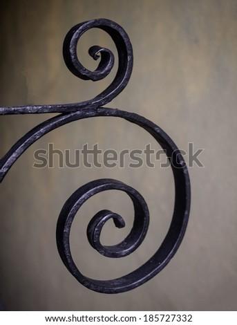 Old wrought iron design on gate in Charleston, SC. - stock photo