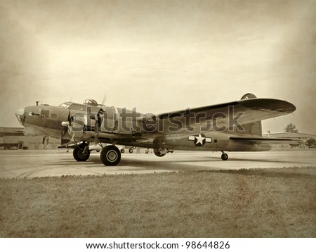 Old WW2 era bomber preparing for takeoff - stock photo