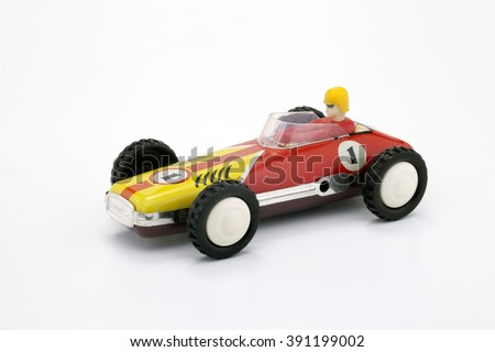 Old yellow and red racing car - vintage toy car - white background - number one - stock photo