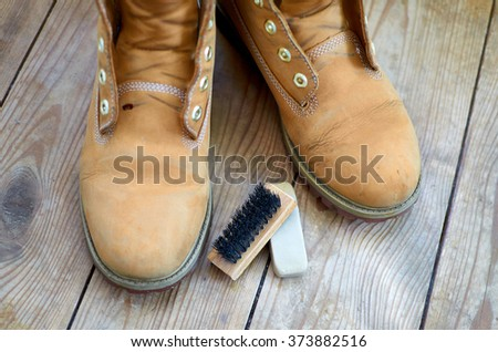 old yellow leather boots cleaning kit