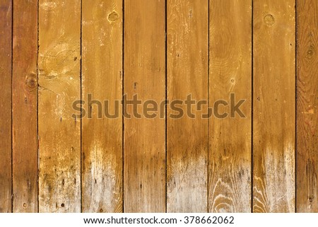 Old yellow painted wooden plank texture background