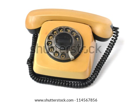 old yellow phone on a white background
