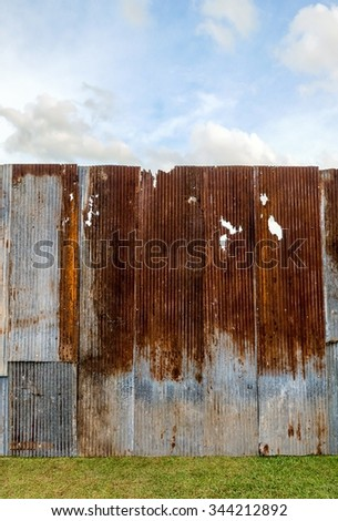 Old zinc and sky - stock photo