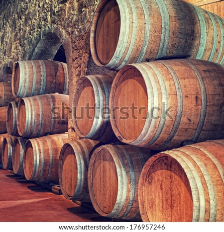 olden casks of different sizes hold Port fortified wine to mature in wine cellars - stock photo