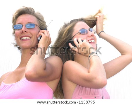 Older and younger women on cell phones - stock photo