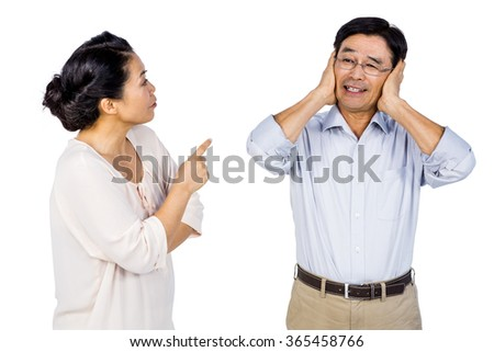 Older asian couple having an argument on white background - stock photo