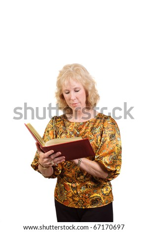 Older attractive blond-haired business woman checking in Address book isolated over white - stock photo