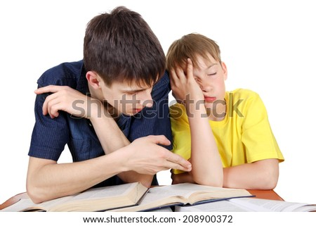 Older Brother and Annoyed Kid on the School Desk on the white background - stock photo