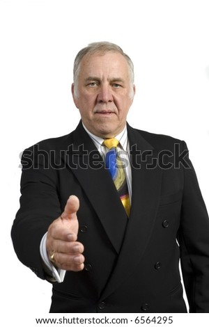 older businessman in a suit holding out hand to shake isolated on white