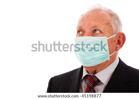 Older businessman protected with a face mask (isolated on white) - stock photo
