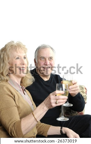 older couple celebrating years of marriage, toasting with a glass of wine - stock photo