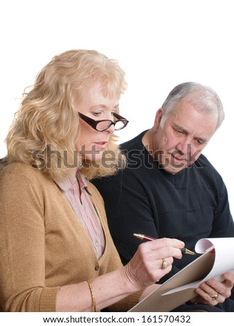 Older couple discussing finances  - stock photo