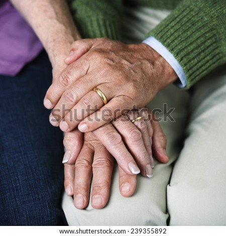 Older Couple Holding Hands - stock photo