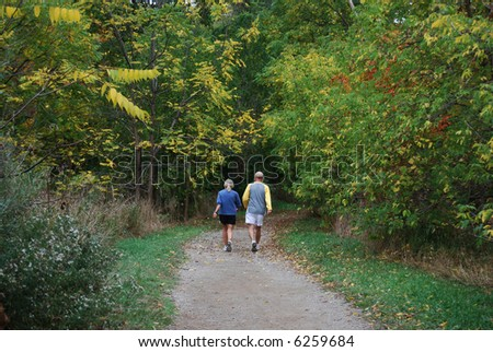 older couple strolling in park - stock photo