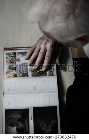 Older depressed man remembering his wife - stock photo