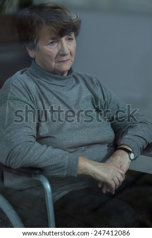 Older depressed woman with health problem - stock photo