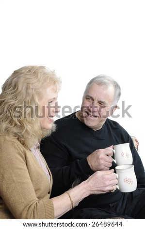 Older enjoying a cup of coffee together over a white background - stock photo