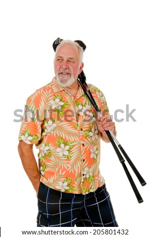 Older golfer in brightly colored floral shirt with several golf clubs over shoulder, isolated on white  - stock photo
