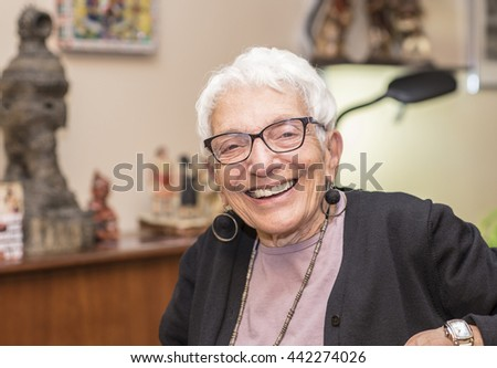 Older Independent Woman in her Apartment Smiling & Happy - stock photo