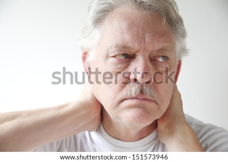 older man experiences soreness in his neck