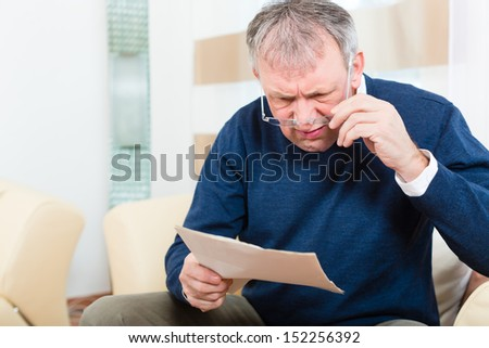 Older man or Senior have received a letter, maybe it's a reminder or a Bill - stock photo