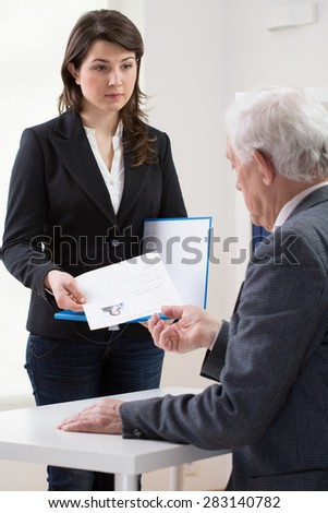 Older manager hiring young woman as an office help