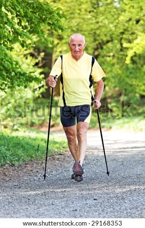 Older Senior Nordic walking for better fitness - stock photo