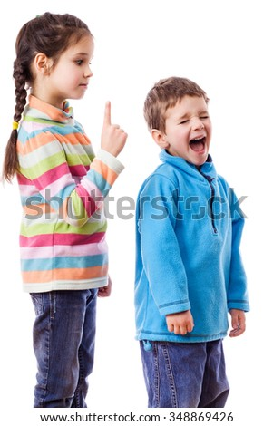 Older sister scolds his crying brother, mutual relations concept, isolated on white - stock photo