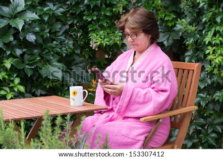 Older woman typing message - stock photo